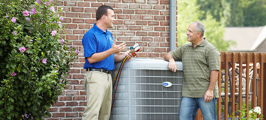 HVAC technician performing maintenance on an Air Conditioner
