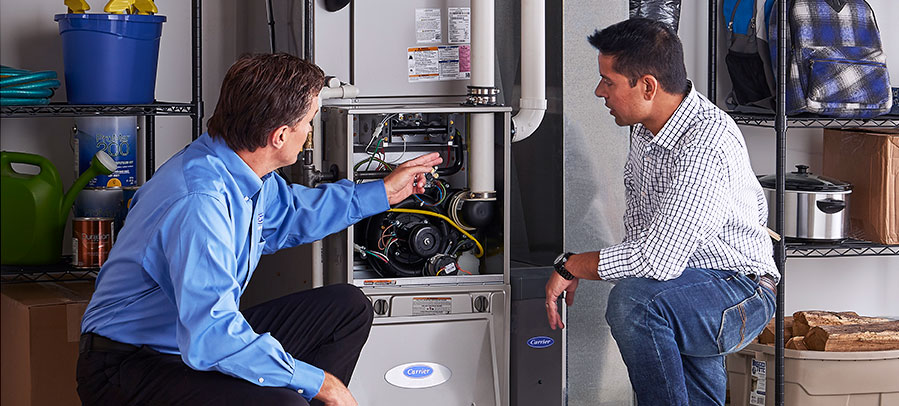 HVAC technician discussing furnace repairs with the homeowners
